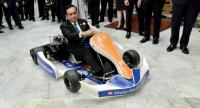 Prime Minister General Prayut Chan-o-cha drives an electric go-cart around Government House yesterday after it was brought to the compound as an exhibit of inventions by students in the Eastern Economic Corridor.