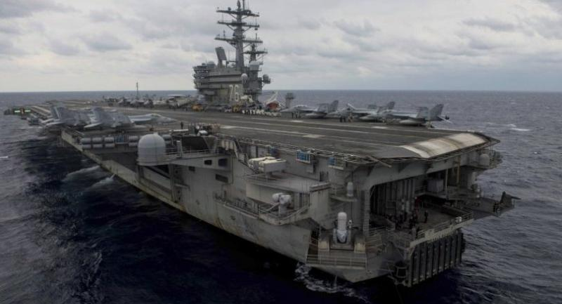 A handout photo made available by the US Navy on 20 November 2017 shows the forward-deployed aircraft carrier and flagship of Carrier Strike Group Five, USS Ronald Reagan (CVN 76), steaming throught the Philippine Sea during Annual Exercise 2017.