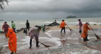 Workers in Songkhla clean areas near Mermaid statue in Samira Beach in Songkhla province on Thursday ahead of the visit of the prime minister and his Cabinet next week.