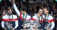 France's Julien Benneteau, Pierre-Hugues Herbert, Richard Gasquet and Lucas Pouille celebrate with the trophy after winning the Davis Cup World Group final tennis match between France and Belgium at The Pierre Mauroy Stadium in Villeneuve d'Ascq near