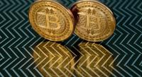 This June 17, 2014 file photo taken in Washington, DC shows bitcoin medals./AFP