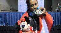 Sopita Tanasan kisses her three gold medals.