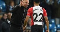 Manchester City's Spanish manager Pep Guardiola reacts as he talks with Southampton's English midfielder Nathan Redmond following the English Premier League football match between Manchester City and Southampton.
