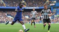 Chelsea's Nigerian midfielder Victor Moses (L) crosses the ball opposed by Newcastle United's Scottish midfielder Matt Ritchie (R) during the English Premier League football match between Chelsea and Newcastle United at Stamford Bridge in London.