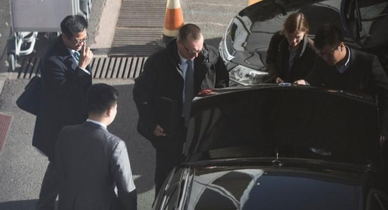 UN under secretary general for political affairs Jeffrey Feltman (C) arrives to take a flight for North Korea at the International Airport of Beijing on December 5.//AFP