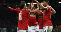 Manchester United's English striker Marcus Rashford (R) celebrates with teammates after scoring their second goal during the UEFA Champions League Group A football match between Manchester United and CSKA Moscow at Old Trafford in Manchester.
