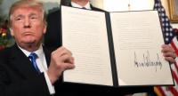 President Donald J. Trump signs his proclamantion about his controversial decision to formally recognize Jerusalem as the capital of Israel.//AFP