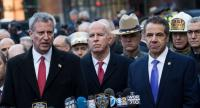 (L to R) New York City Mayor Bill de Blasio, New York City Police Commissioner James O'Neill and New York Governor Andrew Cuomo hold a press briefing outside the New York Port Authority Bus Terminal, December 11.//AFP