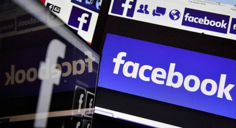 This file photo taken on November 20, 2017 shows logos of US online social media and social networking service Facebook in Nantes, France./AFP