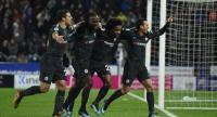Chelsea's Spanish midfielder Pedro (R) celebrates with teammates after scoring their third goal during the English Premier League football match between Huddersfield Town and Chelsea at the John Smith's stadium in Huddersfield.
