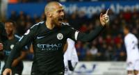 Manchester City's Spanish midfielder David Silva celebrates after scoring their third goal during the English Premier League football match between Swansea City and Manchester City at The Liberty Stadium in Swansea.