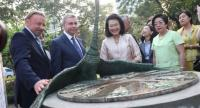 From left, Kirill Barsky, Russia's Ambassador to Thailand, and Sergey Cheremin, head of Moscow's External Economic and International Relations Department, present a sundial to Wanvilai Promlakano, Bangkok's deputy governor, at Lumpini Park.