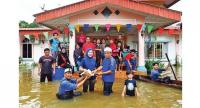 Family members and village residents hold 'Balik Tiga Hari' ceremony for a newlywed couple despite flash-floods