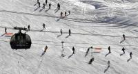 (FILES) This file photo taken on November 26, 2016 shows people skiing down a slope on the opening weekend of the ski season at Val Thorens ski resort, in the French Alps. / AFP PHOTO