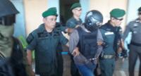 File photo : Police accompany Ronnachai for re-enactment of his crime.