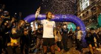 "Rock star Artiwara Kongmalai, better known as ""Toon Bodyslam"", reaches his final destination in Chiang Rai's Mae Sai district yesterday evening after his months-long charity run ."