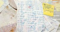 Some of the documents recovered from a raided cockfighting site which appear to reveal a network of payoffs across a Cambodian province.