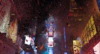 The ball drops to enter in the new year during New Year's Eve celebrations in Times Square on January 1, 2018 in New York. / AFP PHOTO