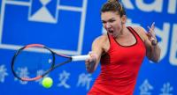 Simona Halep of Romania hits a return against Duan Yingying of China during their women's singles second round match at the WTA Shenzhen Open tennis tournament in Shenzhen