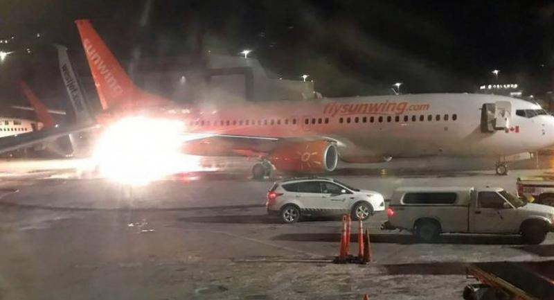A picture obtained from the Facebook account of Connie Carson shows a Sunwing's airplene (front) colliding with a WestJet plane (L rear) on January 5, 2018, at Toronto's Pearson Airport.  / AFP PHOTO / FACEBOOK
