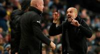 Manchester City's Spanish manager Pep Guardiola (R) gestures to Burnley's English manager Sean Dyche (L) during the English FA Cup third round football match between Manchester City and Burnley at Etihad Stadium in Manchester.