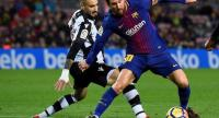 Levante's Uruguayan defender Erick Cabaco (L) vies with Barcelona's Argentinian forward Lionel Messi during the Spanish league football match FC Barcelona vs Levante UD at the Camp Nou stadium in Barcelona on January 7, 2018. / AFP PHOTO
