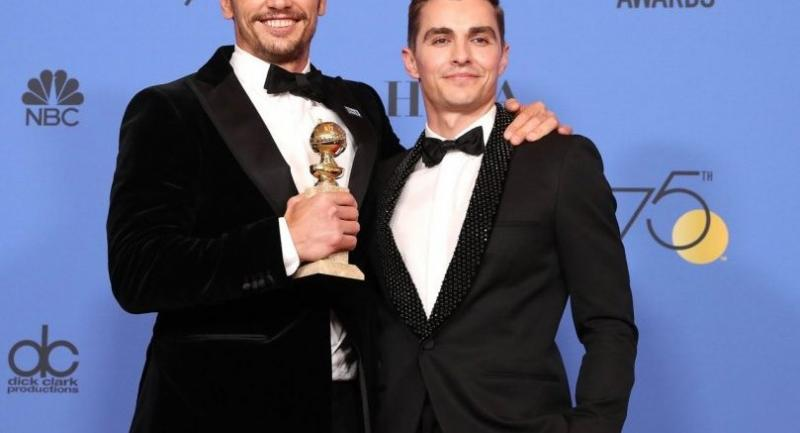 James Franco (L) holds the award for Best Performance by an Actor in a Motion Picture - Musical or Comedy for 'The Disaster Artist' in the press room during the 75th annual Golden Globe Awards ceremony./EPA