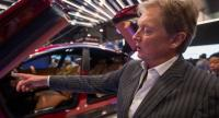 Henrik Fisker, founder, Chairman and CEO of Fisker Inc., speaks next to a Fisker EMotion all-electric vehicle that uses LiDAR technology at CES in Las Vegas, Nevada, January 9, 2018. / AFP PHOTO