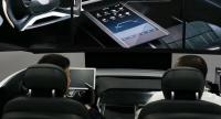 Attendees experience the Intelligent Personal Cockpit at the Hyundai booth during CES 2018 at the Las Vegas Convention Center on January 9, 2018 in Las Vegas, Nevada. /AFP