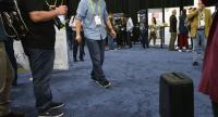 An exhibitor demonstrates the ForwardX Robotics self-driving CX-1 suitcase during the CES Unveiled event on the sidelines of CES 2018 in Las Vegas, Nevada on January 7, 2018.  / AFP PHOTO