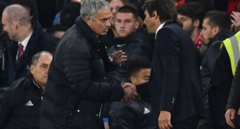 This file photo taken on October 23, 2016 shows Manchester United's Portuguese manager Jose Mourinho (L) shaking with Chelsea's Italian head coach Antonio Conte (R) after their English Premier League game.