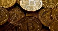 (FILES) This file photo taken in Washington, DC, on May 1, 2014 shows bitcoin medals. / AFP PHOTO