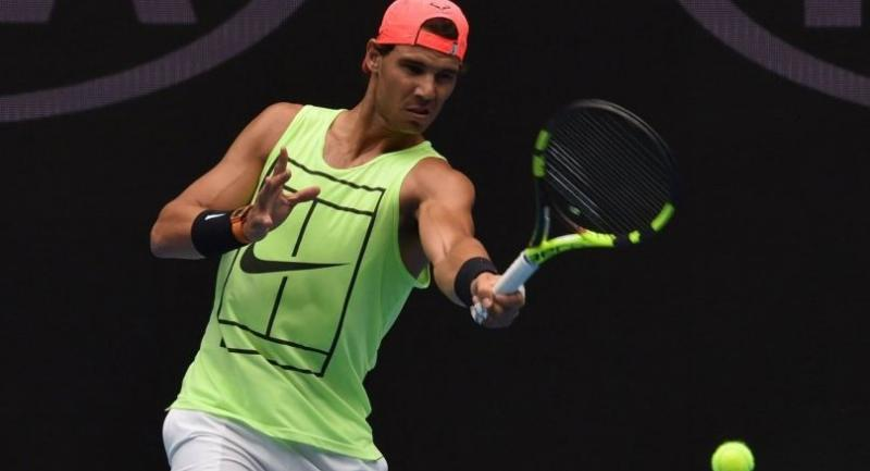 Spain's Rafael Nadal hits a return during a practice session ahead of the Australian Open tennis tournament in Melbourne on January 13, 2018. / AFP PHOTO / PAUL CROCK