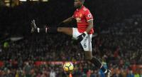Manchester United's French midfielder Paul Pogba controls the ball during the English Premier League football match between Manchester United and Stoke City at Old Trafford in Manchester, north west England, on January 15, 2018. / AFP PHOTO