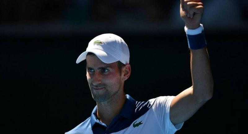 Serbia's Novak Djokovic reacts after a point against Donald Young of the US during their men's singles first round match on day two of the Australian Open tennis tournament in Melbourne on January 16, 2018. / AFP PHOTO