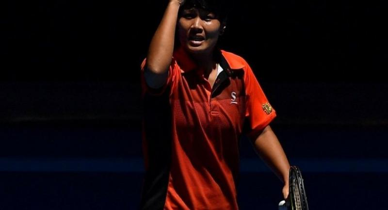 Thailand's Luksika Kumkhum celebrates her victory against Switzerland's Belinda Bencic during their women's singles second round match on day three of the Australian Open tennis tournament in Melbourne on January 17, 2018. / AFP PHOTO