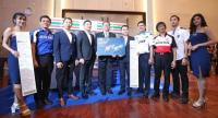 Sports Authority of Thailand governor Sakon Wannapong shows the first Ptt Thailand Grand Prix ticket that he purchased.