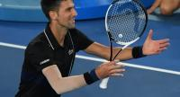 Serbia's Novak Djokovic celebrates beating Spain's Albert Ramos-Vinolas in their men's singles third round match on day six of the Australian Open tennis tournament in Melbourne on January 20, 2018. / AFP PHOTO