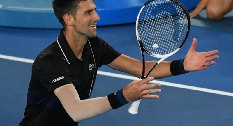 Serbia's Novak Djokovic celebrates beating Spain's Albert Ramos-Vinolas in their men's singles third round match on day six of the Australian Open tennis tournament in Melbourne on January 20, 2018. / AFP PHOTO
