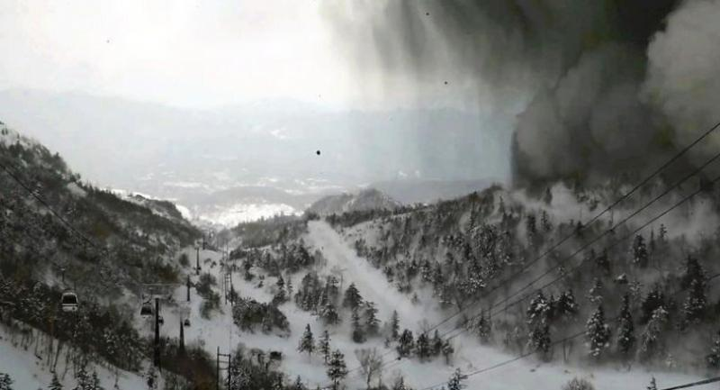A ski resort in Kusatsu, Gunma Prefecture, is partially covered by black smoke//The Japan News