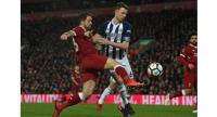 Liverpool's English striker Danny Ings (L) shoots under pressure from West Bromwich Albion's Northern Irish defender.