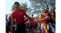 Tiger Woods high fives a fan during the final round of the Farmers Insurance Open at Torrey Pines South on January 28, 2018 in San Diego, California. Donald Miralle/Getty Images/AFP