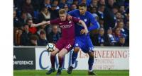 Manchester City's Belgian midfielder Kevin De Bruyne (L) vies with Cardiff City's Serbian midfielder Marko Grujic (R) during the English FA Cup fourth round football match between Cardiff City and Manchester City at Cardiff City Stadium in Cardiff, s