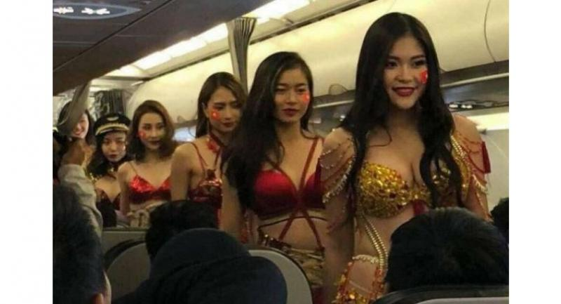 VietJet sent scantily clad models to join Vietnam's under-23 men's football squad on a flight home from China//PHOTO: FACEBOOK/NGO THANH VAN.