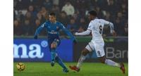 Arsenal's Swiss midfielder Granit Xhaka (L) vies with Swansea City's Dutch midfielder Leroy Fer during the English Premier League football match between Swansea City and Arsenal at The Liberty Stadium in Swansea, south Wales on January 30, 2018. Swan