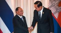 Prime Minister Prayut Chan-o-cha shakes hands with Cambodia's National Assembly President Heng Samrin as the latter leads a 32-strong delegation to visit Thailand at the invitation of the Thai National Legislative Assembly.