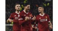 Liverpool's German midfielder Emre Can (C) celebrates scoring the opening goal during the English Premier League football match between Huddersfield Town and Liverpool .