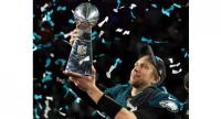 Nick Foles #9 of the Philadelphia Eagles celebrates with the Lombardi Trophy after defeating the New England Patriots 41-33 in Super Bowl LII at U.S. Bank Stadium on February 4, 2018 in Minneapolis.