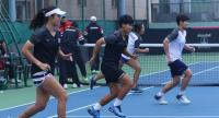 Luksika Kumkhum, wearing the dark kit in the centre, and her Fed Cup teammates go through their training drills on Tuesday.