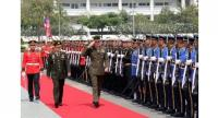 US General Joe Dunford (C), who is chairman of the Joint Chiefs of Staff, salutes as he inspects a Thai honour guard alongside his Thai counterpart General Tarnchaiyan Srisuwan (2nd L) during a ceremony in Bangkok on February 7.//AFP